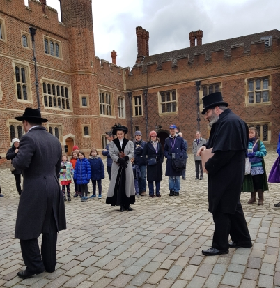 Three of the players at Base Court at Hampton Court Palace