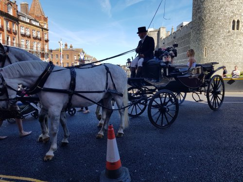 TV celebrity Amanda Holden in a carriage outside the castle