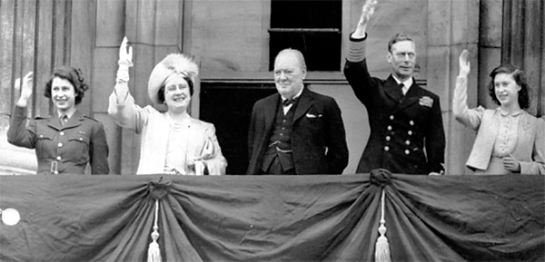 The British royal family celebrating VE Day on the balcony of Buckingham Palace with Winston Churchill