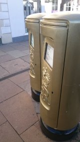 Pair of gold post boxes dedicated to Paralympian James Roe in Stratford-upon-Avon