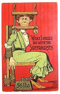 A suffragist tied to a chair, with weighted shackles around her ankles and her head held in a vice to stop her from speaking