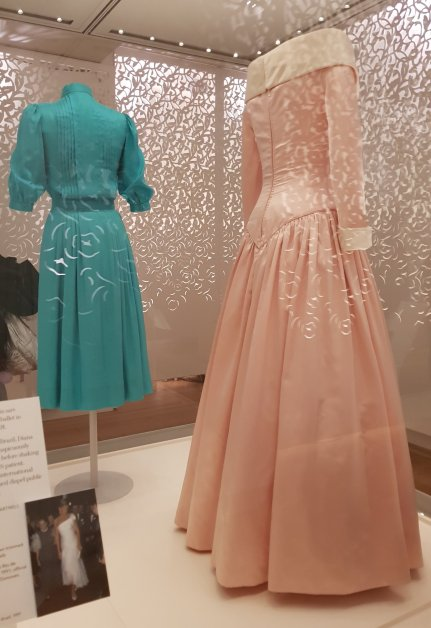 The rear​ of two Catherine Walker dresses that Diana wore for official functions, in 1983 and 1987 (left to right).