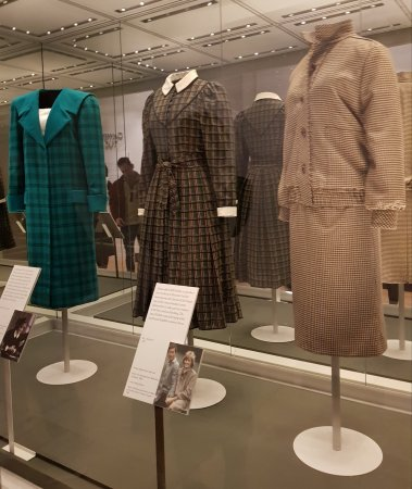 Left to right: an Emmanuel bold design from 1985 worn on an official visit to Italy, a Caroline Charles tartan day dress worn in 1982 for the Braemar Highland Games and the tweed suit worn during her honeymoon at Balmoral.