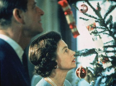Queen Elizabeth II and the Duke of Edinburgh looking at their Christmas tree in 1969
