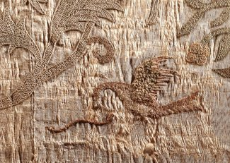 The Bacton Altar Cloth, a dragon attacking a snake